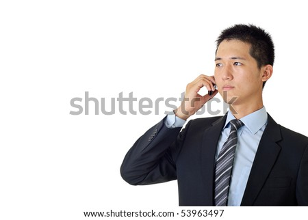 Young businessman listen on cellphone on white background. - stock photo