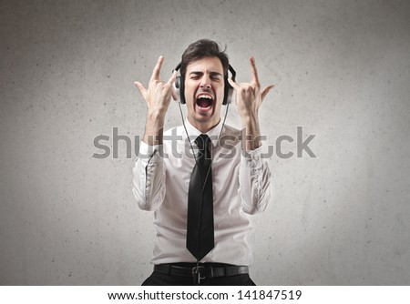 young businessman listening music - stock photo