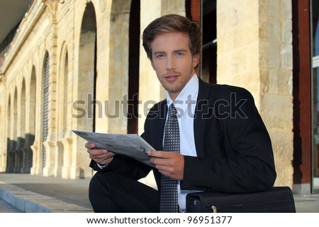 Young businessman looking at a paper