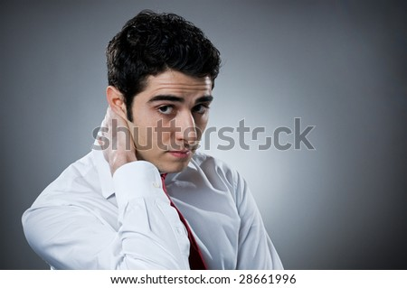 Young businessman looking at camera in a worried and questioning expression, space for text