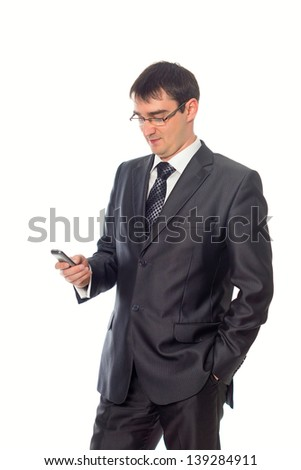 young businessman looking at cell phone, isolated image