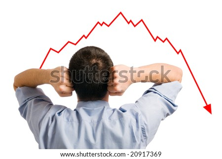 Young businessman looking at his declining share. Bad business, economy in recession! - stock photo