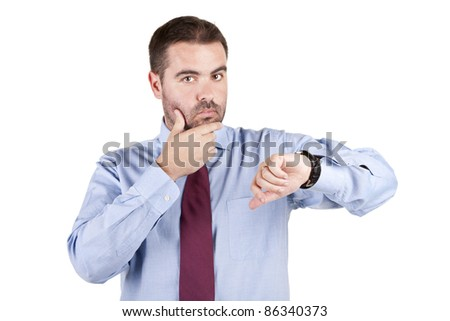 young businessman looking at his watch over white background