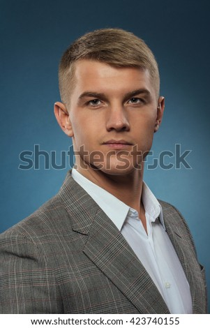 young businessman looking at the camera - stock photo