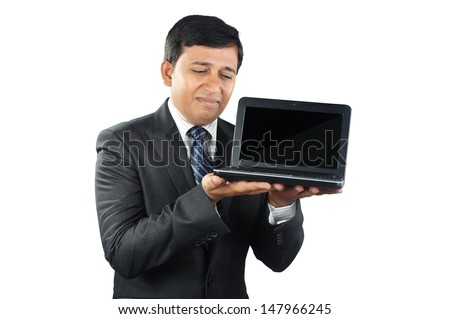 Young Businessman looking depressed with Laptop