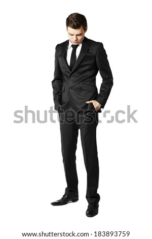 Young businessman looking down. Man against white background - stock photo