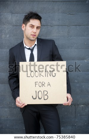 Young businessman looking for a job - stock photo