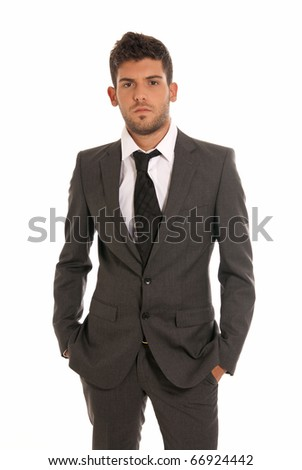 Young businessman looking serious hands in pockets isolated on white background - stock photo