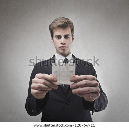 young businessman looking the bill - stock photo