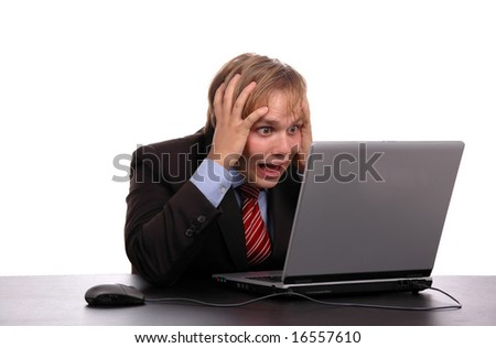 young businessman looking the laptop with hands on head