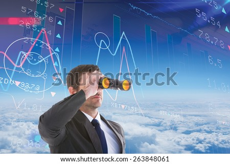 Young businessman looking through binoculars against stocks and shares - stock photo