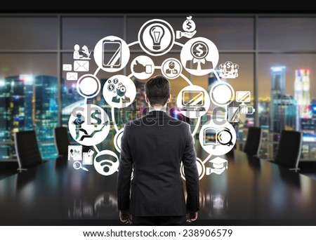 young businessman looking to plan and business symbol - stock photo