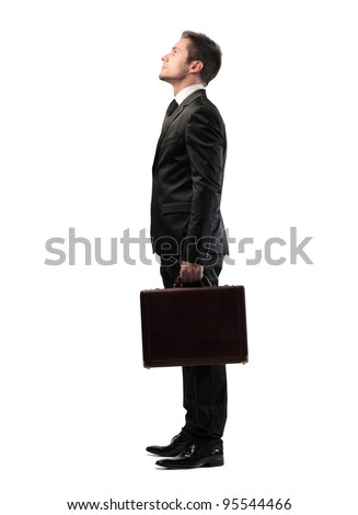 Young businessman looking up - stock photo