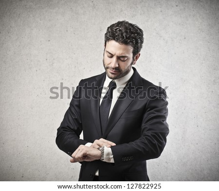young businessman looking watch