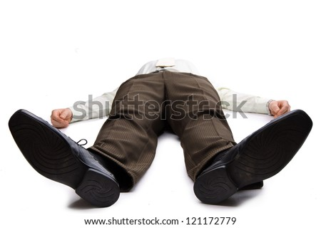 Young businessman lying on the floor - stock photo