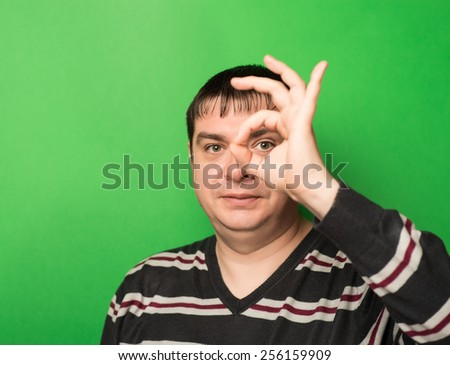 Young businessman makes OK sign  - stock photo