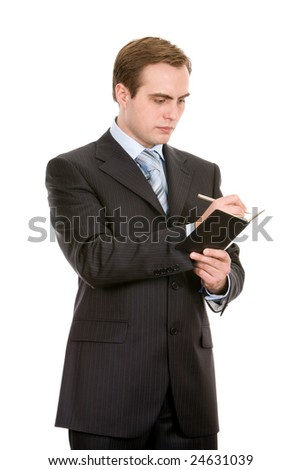 Young businessman making a note. Isolated on white.