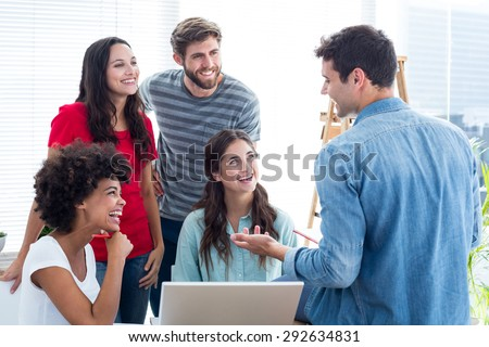Young businessman making a speech in a meeting at office