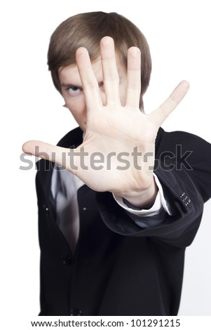 Young businessman making stop sign - stock photo