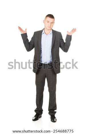 Young businessman making undecided gesture. - stock photo