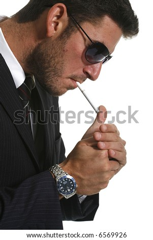 Young businessman man smoking cigarette - stock photo