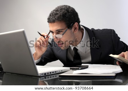 Young businessman observing the screen of his laptop
