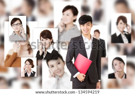 Young businessman of Asian stand in front of business portrait wall. - stock photo
