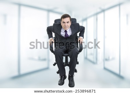 young businessman on a chair at the office