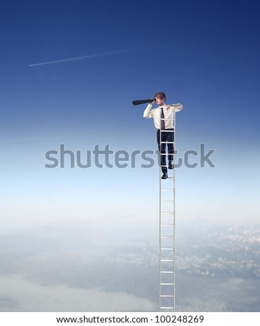 Young businessman on a ladder in the sky using binoculars - stock photo
