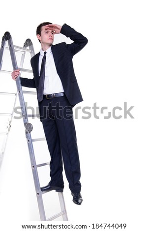 Young businessman on a ladder searching for possibilities - stock photo