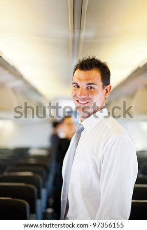 young businessman on airplane - stock photo
