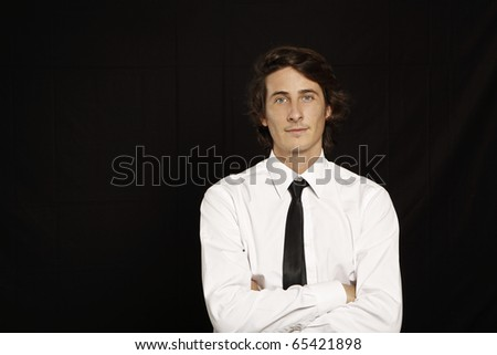 young businessman on black background - stock photo