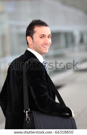 Young businessman on business travel - stock photo