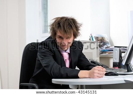 Young businessman on office workplace with computer
