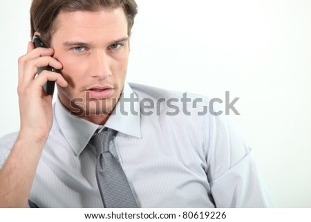 Young businessman on telephone - stock photo