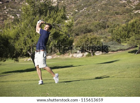 Young Businessman on the Golf Course - stock photo