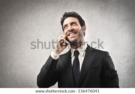 young businessman on the phone - stock photo
