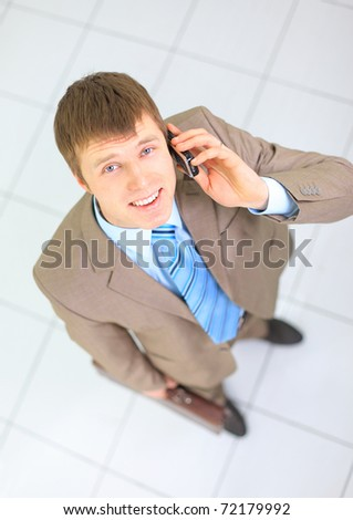 Young businessman on the phone in his office - stock photo