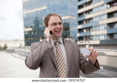 Young businessman on the phone (outdoor the office) - stock photo