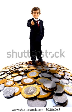 Young Businessman on top of a many coins - stock photo