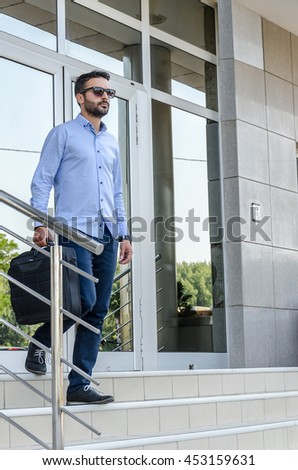 Young businessman or lawyer enters the building or workplace