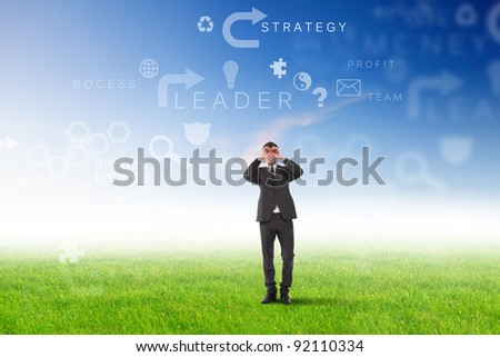 Young businessman outdoor with business symbols on the sky background - stock photo