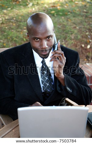 Young businessman outside dressed in a suit - stock photo