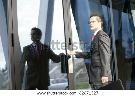 young businessman over modern background - stock photo
