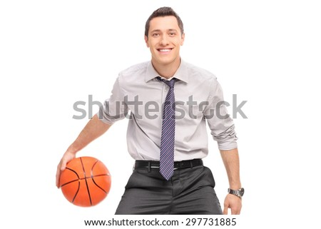 Young businessman playing basketball and looking at the camera isolated on white background