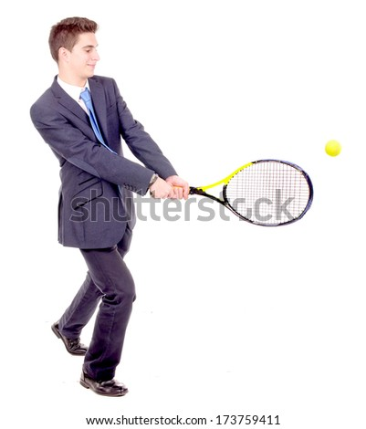 young businessman playing tennis isolated in white - stock photo