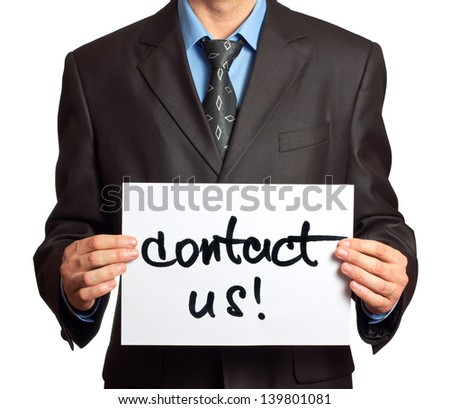 Young businessman points on a card Contact Us on a white background - stock photo