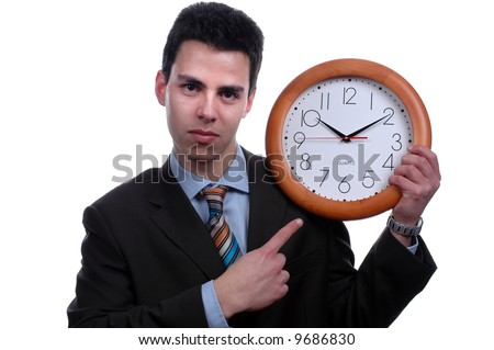 young businessman poiting to wall clock