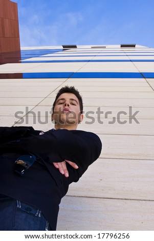 Young businessman portrait against urban background - stock photo