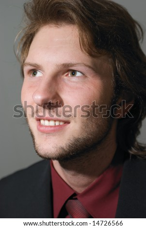 young businessman portrait with red shirt and tie